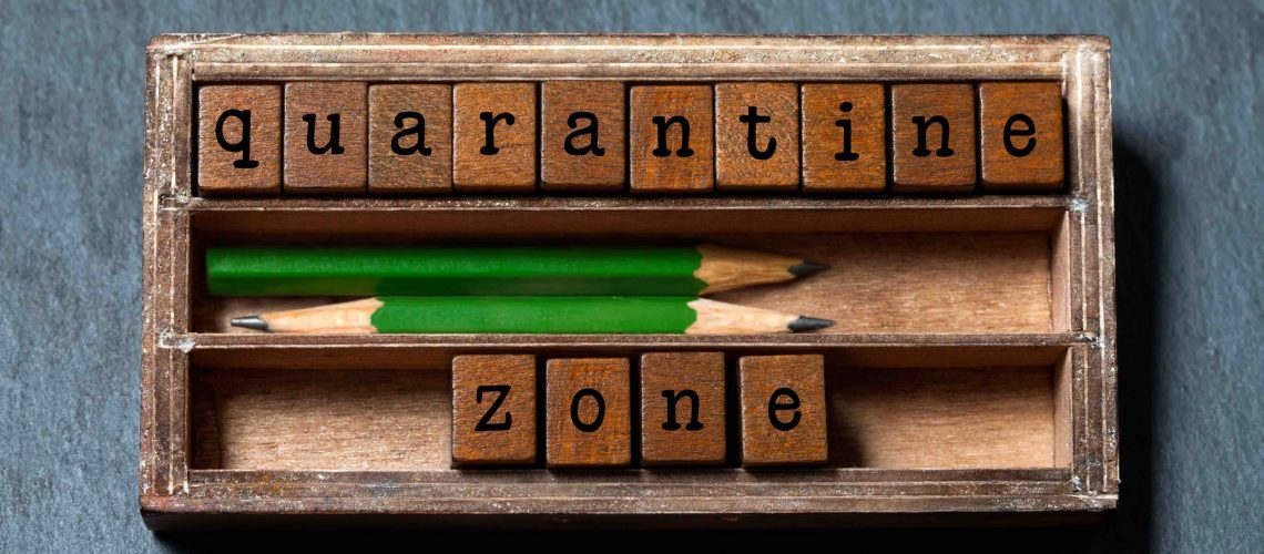 Quarantine zone. Retro style poster concept. Vintage box, wooden cubes with old style letters, green pencils. Gray stone background